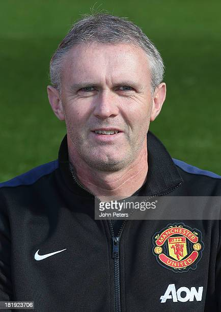 Kit Manager Alec Wylie of Manchester United poses at the annual club photocall at Old Trafford on September 26 2013 in Manchester England