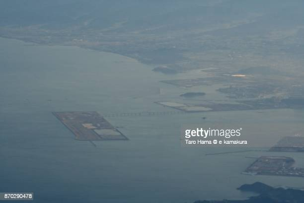 Kitakyushu airport in Fukuoka prefecture in Japan sunset time aerial view from airplane