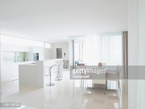 Kitchen and living room in modern home : Stock Photo