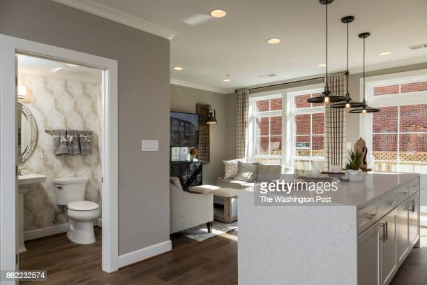Kitchen and rear Living area in the model Townhome at Mayfair on Main Street on September 29 2017 in Fairfax Virginia
