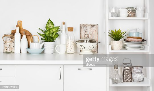 Kitchen bench and shelf with various utensils on white background : Stock Photo