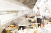 motion blur chefs of a restaurant kitchen