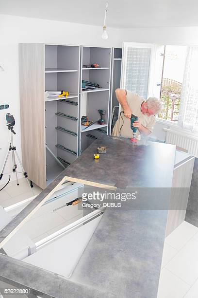 Kitchen fitter men drilling