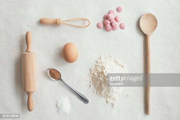 Kitchen ingredients and utensils on white background