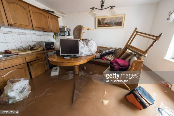 A kitchen is flooded in Rhueden northern Germany on July 26 2017 Some parts of lower saxony are overflooded after heavy rainfall / AFP PHOTO / dpa /...