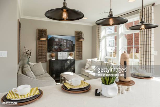 Kitchen Island and rear Living area in the model Townhome at Mayfair on Main Street on September 29 2017 in Fairfax Virginia