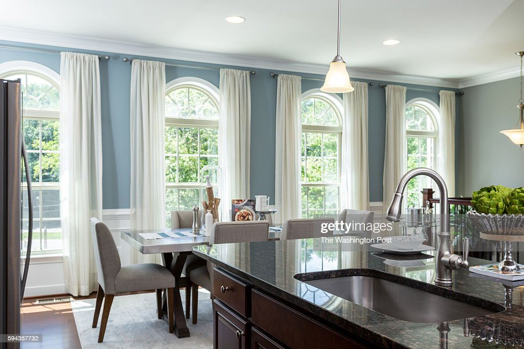 Kitchen Island and View of Front Dining Area in the Glasgow Model at Admirals Ridge on August 11 2016 in Arnold Maryland