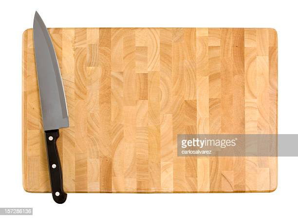 Kitchen knife on a wooden cutting board