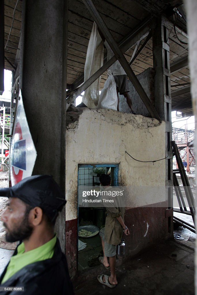 Kitchen of the railway stall under the footover bridge of Kurla station on July 20, 2005 in Mumbai, India.