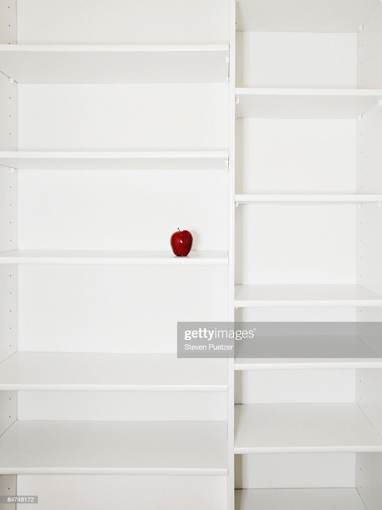 Kitchen pantry shelves displaying single apple : Stock Photo