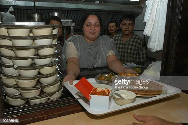 Kitchen Queen Lalitha at her Paratha Point kitchen in Bangalore Karnataka India Food