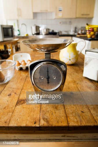 Kitchen scales weighing stock photos and pictures getty for Kitchen scale for baking