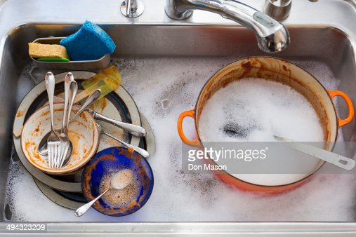Kitchen sink full of dirty dishes