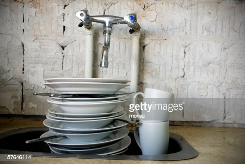 Kitchen sink with dirty dishes