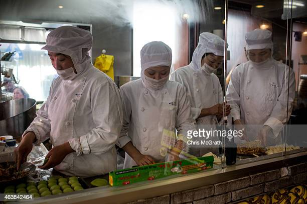 Kitchen staff make dumplings at a store in Yokohama China Town prior to the start of Chinese New Year celebrations on February 19 2015 in Yokohama...
