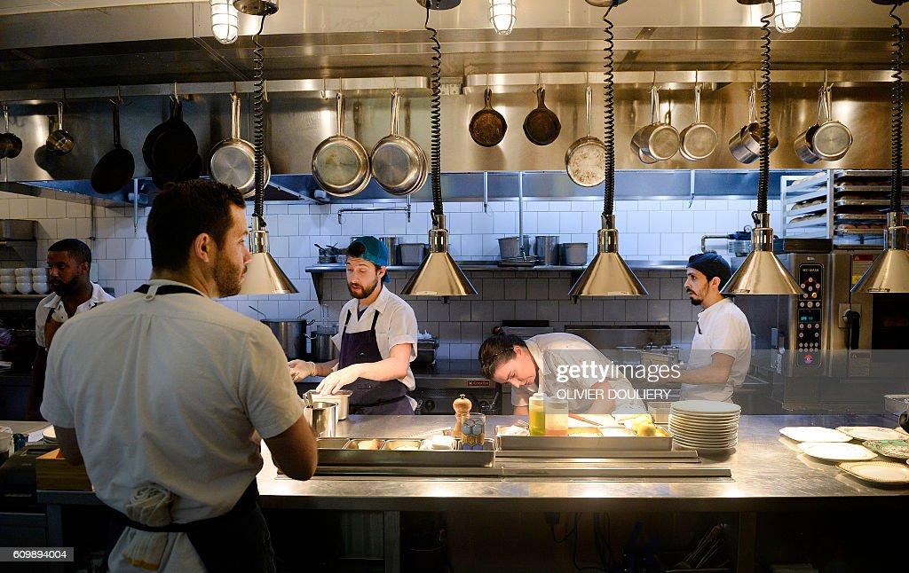Restaurant Kitchen Staff kitchen staff prepare food at pineapple and pearls restaurant, on