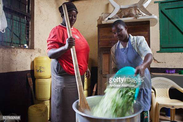 Kitchen staff prepare food for all the pupils at Kibera School Nairobi The school consists of 6 teachers with approximately 60 children in each class...