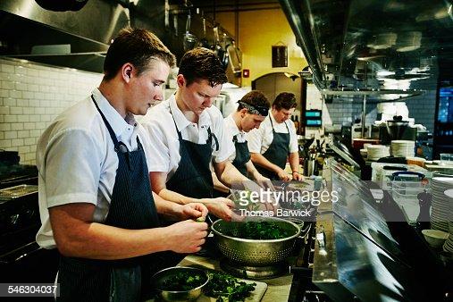 Kitchen staff preparing organic greens for dinner