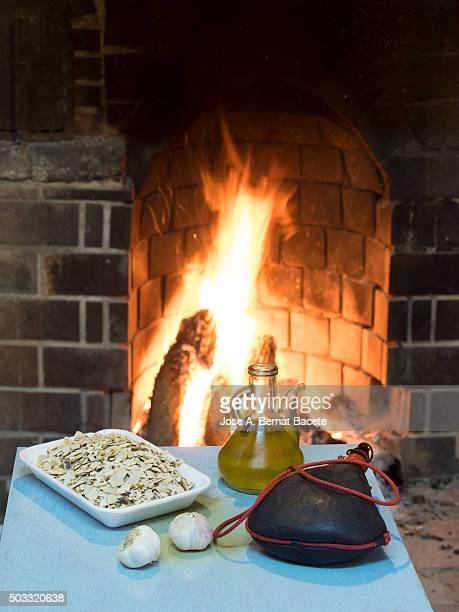Kitchen table with food close to a chimney of fuelwood