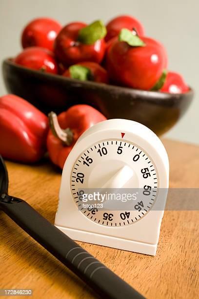 timer da cucina, contatore con cesto di mele e peperoni