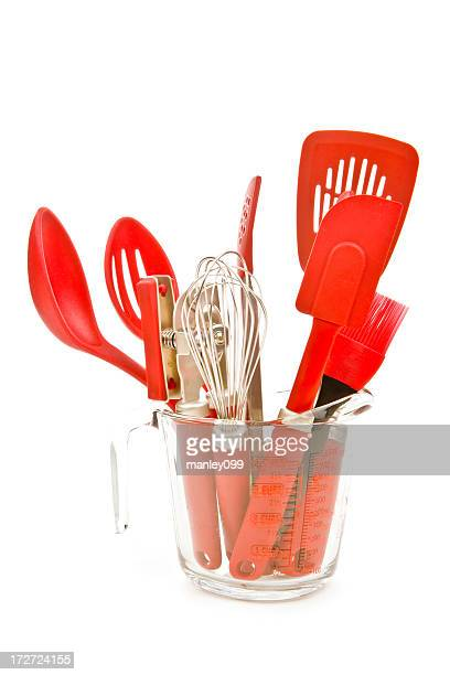 kitchen utensils in a measuring cup