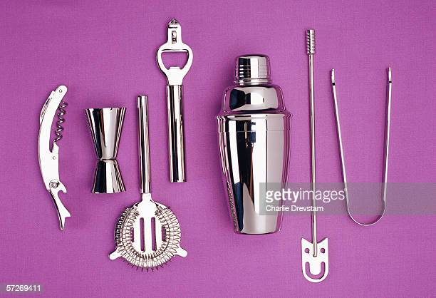 Kitchen utensils in stainless steel on a purple background.
