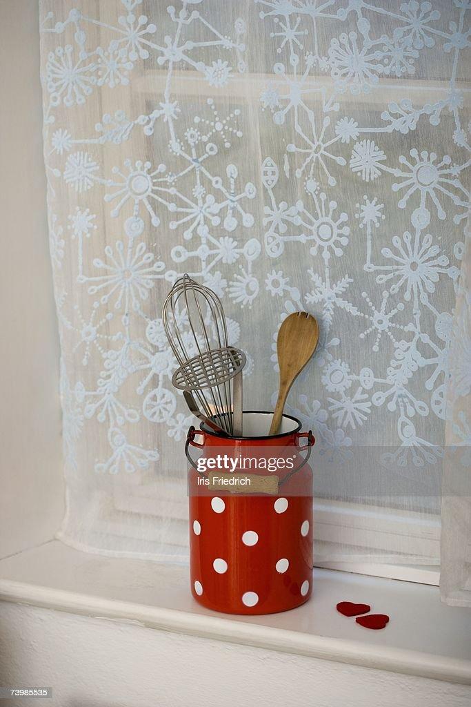 Kitchen utensils on a window sill
