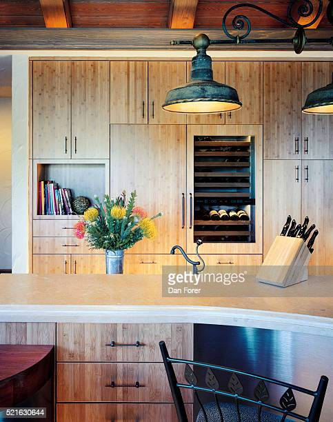 Kitchen with Beamed Ceiling and Rustic Lamps