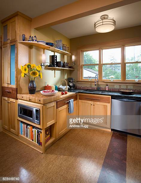 Kitchen With Butcher Block Counter and Cork Floor