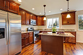 Modern kitchen with hardwood floor and granite counter tops.