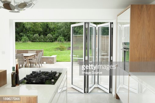Kitchen with open patio doors : Stock Photo