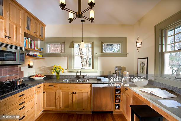 Kitchen With Wood Cabinets and Granite Countertop