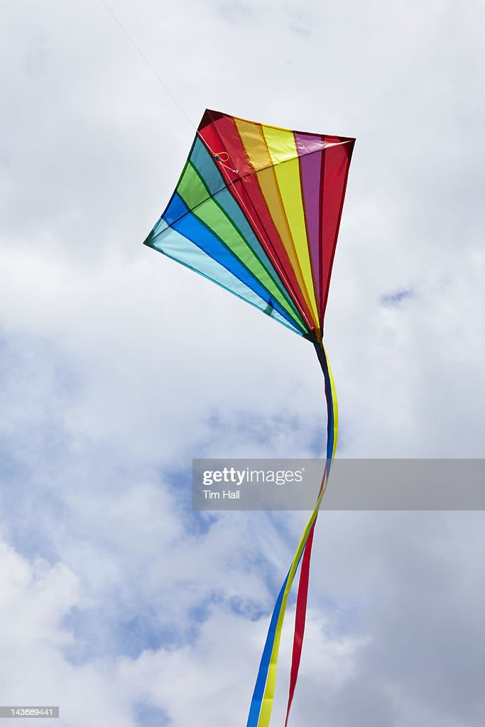 Kite flying in cloudy sky : Stock Photo