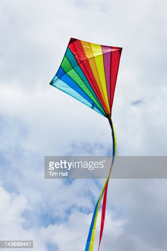 Kite flying in cloudy sky : ストックフォト
