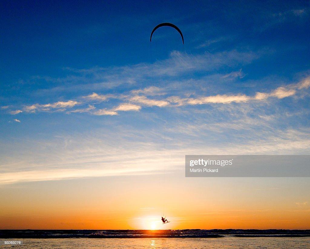 Kite surfer jumps the sunset : Stock Photo