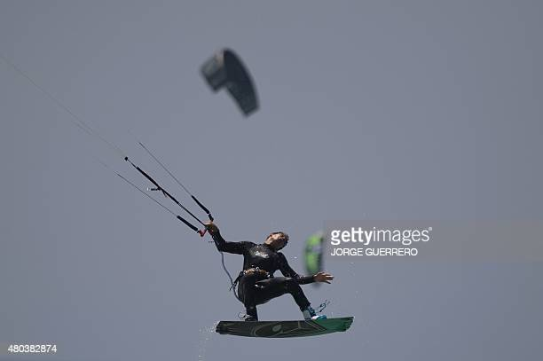 A kite surfer takes part in the Tarifa Kitesurfing World Championships 2015 at Los Lances beach near Tarifa on July 11 2015 AFP PHOTO/ JORGE GUERRERO