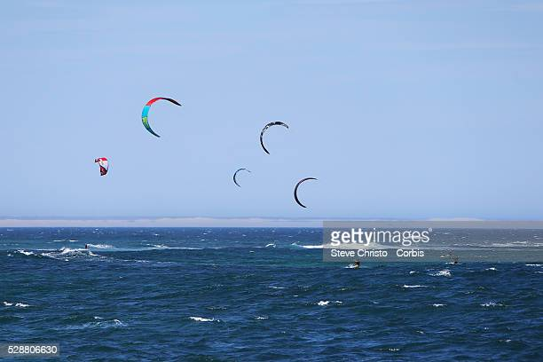 Kite Surfers enjoy the windy conditions at Nobby's beach Newcastle in New South Wales Kitesurfing or kiteboarding is a surface water sport combining...