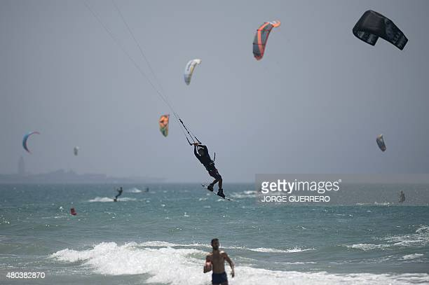 Kite surfers take part in the Tarifa Kitesurfing World Championships 2015 at Los Lances beach near Tarifa on July 11 2015 AFP PHOTO/ JORGE GUERRERO
