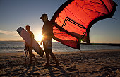 kiteboarding instructor and student on the beach