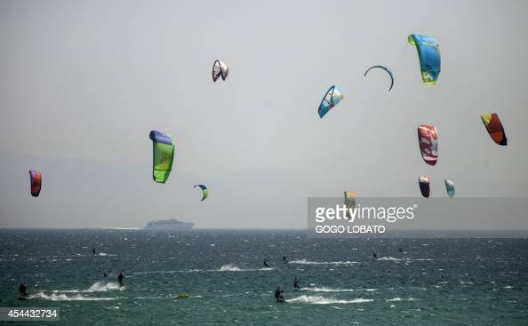 Kitesurfers take part in an attemp of setting the World Record for the largest parade of kitesurfers at Los Lances beach near Tarifa on August 31...