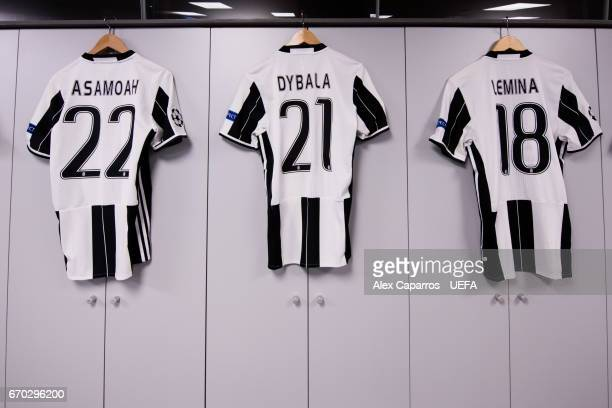 Kits of Kwadwo Asamoah Paulo Dybala and Mario Lemina of Juventus are prepared in the dressing room during the UEFA Champions League Quarter Final...