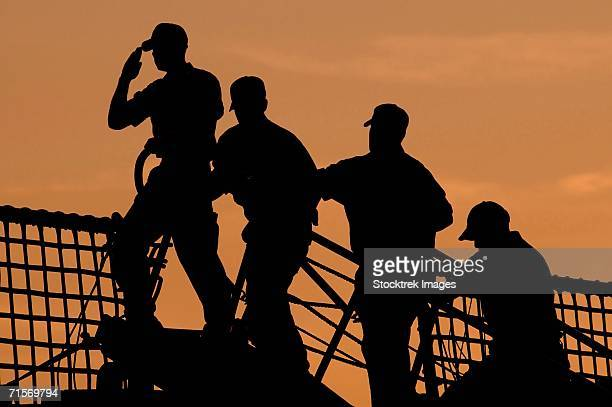 'Kittery, Maine (July 19, 2005) - A U.S. Coast Guard crewman followed by three other crewmen salutes the American flag before coming aboard the USCGC Campbell (WMEC 909). '