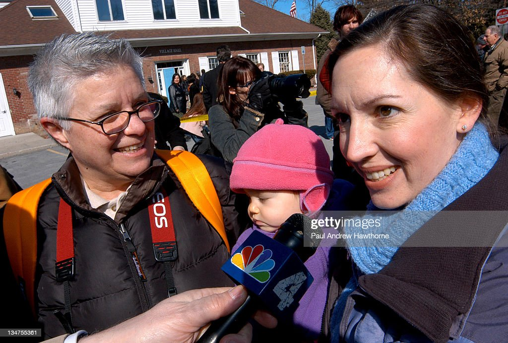 Kitty and Kim Lerin with their oneyearold daughter Mia of New Paltz talk to the media after arriving at Village Hall hoping to be married only to...
