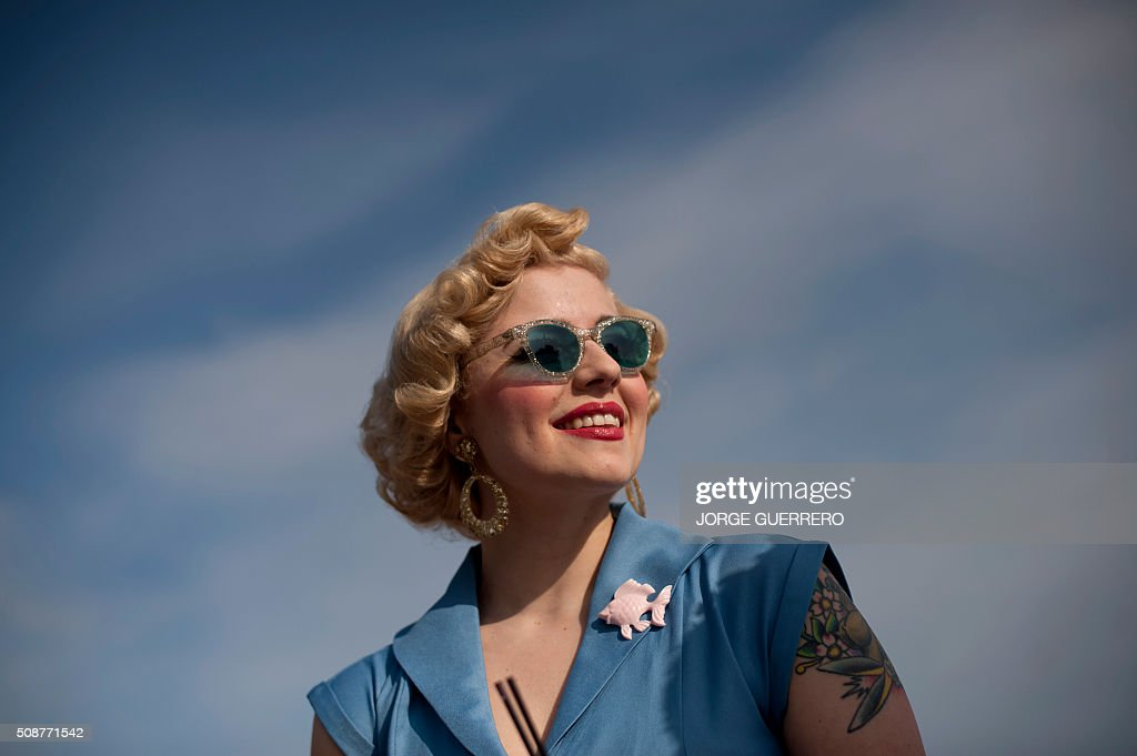 Kitty Steiner, 32 dressed in fifties-style clothes smiles during the 22nd Rockin' Race Jamboree International Festival in Torremolinos on February 6 2016. AFP PHOTO/ JORGE GUERRERO / AFP / Jorge Guerrero