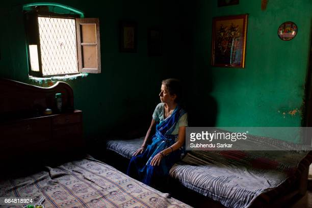 MCCLUSKIEGUNJ RANCHI JHARKHAND INDIA Kitty Texeria one of the AngloIndians living at McCluskiegunj sits in her house She had married a tribal man and...