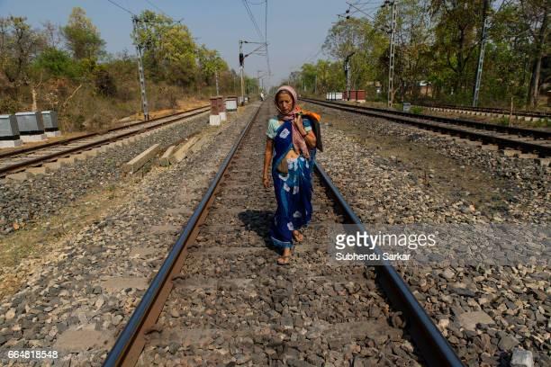MCCLUSKIEGUNJ RANCHI JHARKHAND INDIA Kitty Texeria one of the AngloIndians living at McCluskiegunj walks on the railway tracks to reach her house She...