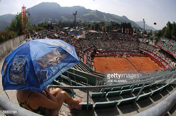 German tennis fan and cat lover Angela Tremmel uses her cat umbrella to get some shade while watching a quarterfinal match between Nicolas Lapentti...
