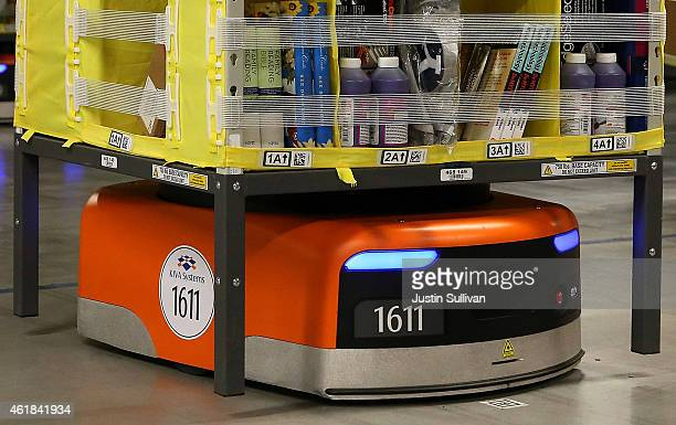 Kiva robot moves a rack of merchandise at an Amazon fulfillment center on January 20 2015 in Tracy California Amazon officially opened its new 12...