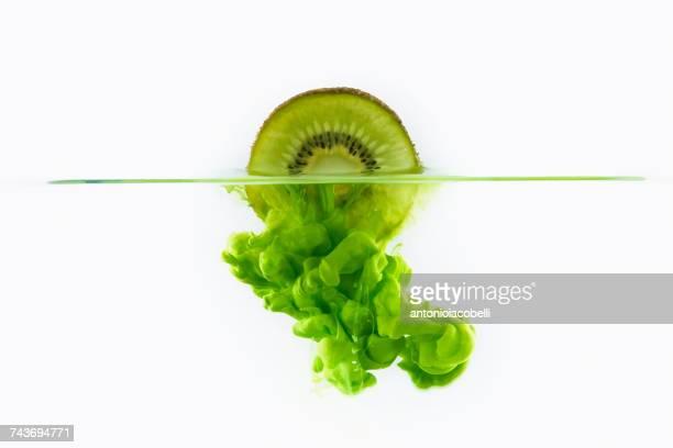 Kiwi fruit dissolving in water