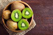 Kiwi fruit on wooden background with copy space